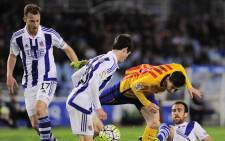 Barcelonas Argentinian forward Lionel Messi (2ndR) vies with Real Sociedad's defender Aritz Elustondo (2ndL), defender Mikel Gonzalez (R) and David Zurutuza during the Spanish league football match Real Sociedad vs FC Barcelona at the Anoeta stadium in San Sebastian on April 9, 2016. Picture: AFP/Ander Gillenea