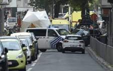Police and ambulance are seen at the site where a gunman shot dead three people, two of them policemen, before being killed by elite officers, in the eastern Belgian city of Liege on 29 May 2018. Picture: AFP