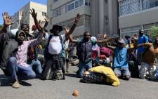 Foreign nationals plead not to be moved by the City of Cape Town officials on 2 March 2020. Picture: Kaylynn Palm/EWN