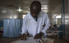 FILE: A doctor at the Jos University Teaching Hospital fills out a patient report card on 28 June 2018. Picture: AFP
