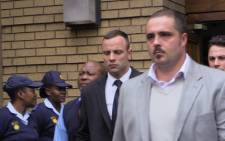 Oscar Pistorius leaves the High Court in Pretoria after his murder trial on 14 April 2014. Picture: Christa van der Walt/EWN.