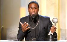 Actor/producer Kevin Hart accepts the Entertainer of the Year award onstage during the 45th NAACP Image Awards presented by TV One at Pasadena Civic Auditorium on 22 February, 2014 in Pasadena, California. Picture: AFP.