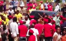 A screenshot from a video of EFF supporters and members of Nehawu and Sasco, wearing ANC t-shirts, clashing ahead of Julius Malema's appearance at Unisa on 26 September 2013. Picture: Belinda Moses/EWN