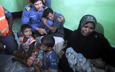 Terrified Muslims hid in their homes after clashes in northwest Myanmar. Picture: AFP