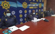 Gauteng Police Commissioner Lieutenant-General Elias Mawela (centre), Deputy Provincial Commissioner Management Advisory Services Major-General Girl Mbele (left) and Johannesburg District Commissioner Major General Max Masha (right) visiting the Johannesburg District Joint Operation Centre monitoring deployment on 23 August 2021. Picture: @SAPoliceService/Twitter