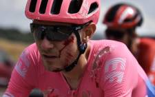 US rider Tejay Van Garderen, with scratches on the face, pedals after a fall during the seventh stage of the 106th edition of the Tour de France cycling race between Belfort and Chalon-sur-Saone, on 12 July 2019. Picture: AFP