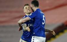 Everton's French defender Lucas Digne (L) and Everton's English defender Michael Keane (R) celebrate after the final whistle of the English Premier League football match between Liverpool and Everton at Anfield in Liverpool, north west England on February 20, 2021. Picture: Phil Noble / Pool / AFP.