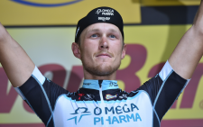 Italian rider Matteo Trentin stands atop the podium after winning stage seven of the 2014 Tour de France. Picture: Official Tour de France Facebook Page.