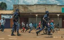 FILE: Uganda police disperse crowds in Kayunga town as they gather to welcome Ugandan musician-turned-politician Robert Kyagulanyi, also known as Bobi Wine, on 1 December 2020. Picture: AFP.