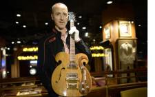 New York : Martin Nolan, Executive Director of Julien's Auction's, holds a rare Vox guitar, played by Beatles John Lennon and George Harrison. Picture:AFP PHOTO.