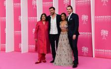 FILE: British-Indian screenwriter and film director Gurinder Chadha (L), creator of the British TV show 'Beecham House', poses with actors (L to R) Gregory Fitoussi, Pallavi Shada and Tom Bateman during the 2019 Cannes International Series festival, in Cannes on 7 April 2019. Picture: AFP