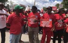 "The Congress of South African Trade Union's Deputy General Secretary, Cde Solly Phetoe, joins Nehawu members during a ""Provincial Day of Action"" march outside Garona Building. Picture: Masechaba Sefularo/EWN."
