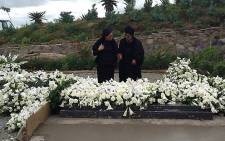 Graça Machel and Winnie Madikizela-Mandela have a moment at Madiba's grave. Picture: Bantu Holomisa/Twitter.