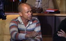 A Davidson community member speaks during a meeting with Gauteng Education MEC Panyaza Lesufi, Picture: Vumani Mkhize/EWN.