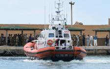 FILE: Boat of the Coast Guards arrives in the Lampedusa harbour on October 6, 2013 after divers recovered ten more bodies from the shipwreck that sank. Picture: AFP