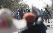 FILE: Ongoing battles between private security guards, police and protestors in the Midrand area over land. Picture: Sethembiso Zulu/Eyewitness News