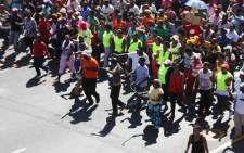 Scores of illegal protesters march through the street as they in Cape Town on 27 February 2014. Picture: Tertia van Rensburg/iWN.