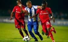 Orlando Pirates players battle for the ball against their Maritzburg United opponent during their Absa Premiership match on 24 April 2019. Picture: @orlandopirates/Twitter