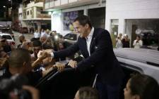 Venezuelan opposition leader and self-proclaimed acting president Juan Guaido greets supporters during a rally at Bolivar Plaza in Caracas, on 11 February 2020. Guaido returned to Venezuela after a 23-day international tour to revitalize pressure on President Nicolas Maduro, his press team announced. Picture: AFP.