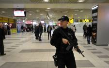 A file picture shows armed Serbian policemen patrol at the Nikola Tesla International airport near Serbian capital Belgrade. Picture: AFP.