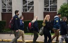 Members of the FBI and others gather on 28 October 2018 outside of the Tree of Life Synagogue after a shooting there left 11 people dead in the Squirrel Hill neighbourhood of Pittsburgh on 27 October 2018. Picture: AFP