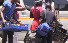 Hundreds of people packed their belongings as they vacated the Methodist church building in Johannesburg on 31 December 2014. Picture:Reinart Toerien/EWN