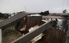 Rebuilding a shack in the Taiwan informal settlement after a concrete fence fell over during a storm in Cape Town. Picture: Cindy Archillies/EWN