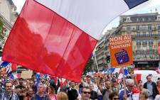 Thousands of people in France have turned out to protest a special virus pass by marching. Picture: @abc7newsbayarea/Twitter.