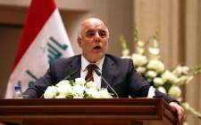 Iraq's new Prime Minister Haider al-Abadi speaks to Iraqi lawmakers before submitting his government for approval in Baghdad on 8 September, 2014. Picture: AFP.