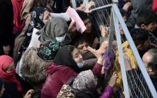 Migrants block the entrance of the Hellinikon camp in Athens in protest at poor living conditions on 6 February  2017, during a visit of Greek Immigration Minister (unseen). Picture: AFP