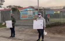 A video screengrab of a small group of parents on 1 June 2020 protesting the reopening of schools at Bergville Primary School in Bishop Lavis.