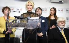US actress Pamela Anderson (C) gives a press conference next to environmental activist Paul Watson (R) on 19 January 2016. Picture: AFP/Eric Feferber.
