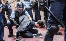 Police detain a man after fights broke out inside a shopping mall between pro-China supporters and anti-government protesters in the Kowloon Bay district of Hong Kong on 14 September 2019. Picture: AFP