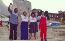 FILE: Students from the SRC standing on the UCT steps with rags over the Cecil John Rhodes statue. Picture: UCT SRC.