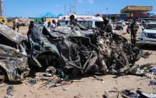 The wreckage of a car that was destroyed during the car bomb attack is seen in Mogadishu, on 28 December 2019. Picture: AFP