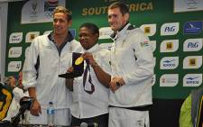 Sports Minister Fikile Mbalula poses with Olympic gold medallists Chad le Clos and Cameron van der Burgh on 9 August 2012. Picture: Christa van der Walt/EWN.