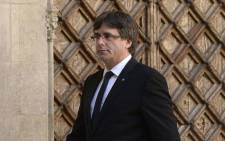 Catalan regional president Carles Puigdemont arrives to give a speech in Barcelona on 20 September 2017. Picture: AFP.