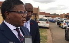 Police Minister Fikile Mbalula addressing the media in Vosloorus during his visit to the home of a policeman who was killed on duty. Picture: Katleho Sekhotho/EWN.
