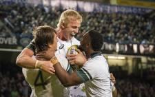 An elated Pieter-Steph du Toit (C) peers deep into Siya Kolisi's (R) eyes after scoring a try. Eben Etzebeth (L) completes the group hug. Picture: Aletta Harrison/EWN