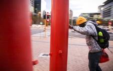 A pedestrian comes head-to-head with strong winds as he tries to make his way home from the MyCitiBus station near the Cape Town Civic Buildings. Picture: Thomas Holder.EWN