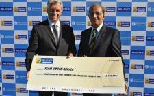 Cricket South Africa CEO Haroon Lorgat is presented with a cheque for $475 000 by ICC CEO Dave Richardson. Picture: Supplied.