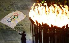 The Olympics flag and flame during the London Games closing ceremony. Picture: London2012.com.