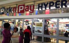 Customers stand outside the Pick n Pay in Maponya Mall on 17 December, 2014. Picture: Masego Rahlaga/EWN.