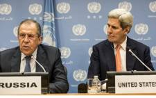 Foreign Minister of Russia Sergey Lavrov and US Secretary of State John Kerry speak at a news conference after a United Nations Security Council meeting on Syria at the United Nations in New York on 18 December 2015. Picture: Getty Images/AFP.