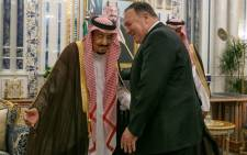 US Secretary of State Mike Pompeo (R) is received by Saudi King Salman bin Abdulaziz at Al Salam Palace in the Red Sea city of Jeddah on 24 June 2019. Picture: AFP