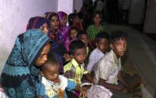 Bangladeshi villagers gather in a cyclone shelter following an evacuation by authorities in coastal villages in the Cox's Bazar district on May 29, 2017 as Cyclone Mora gradually approaches towards the coastline. Bangladesh has evacuated nearly 300,000 people as Cyclone Mora barrelled towards its southeastern coast at speeds of more than 85 kilometres (53 miles) per hour, officials said May 29. Picture: AFP.