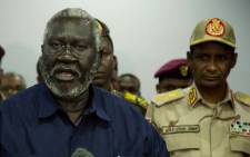 Sudan People Liberation Movement-North and Blue Nile state rebel leader Malik Agar (L) flanked by Sudanese Deputy head of the Transitional Military Council, General Mohamed Hamdan Daglo, during a press conference on 27 July 2019 after a closed door meeting at the presidential palace in Juba, South Sudan. Picture: AFP