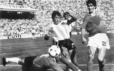 In this file photo taken on June 29, 1982 Argentinian goalkeeper Ubaldo Fillol (Bottom) and captain Daniel Passarella (L) prevent Italian striker Paolo Rossi from scoring, during the World Cup second round soccer match between Italy and Argentina in Barcelona. Paolo Rossi, a hero of Italian football who inspired the national side to victory in the 1982 World Cup, has died aged 64, Italian media reported on December 10, 2020. Picture: AFP