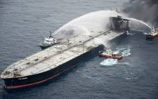 This handout photograph taken on 8 September 2020 and released by Sri Lanka's Air Force shows fireboats battling to extinguish a fire on the Panamanian-registered crude oil tanker New Diamond, some 60 km off Sri Lanka's eastern coast where a fire was reported inside the engine room. Picture: AFP