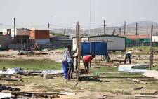 Du Noon residents rebuild their structures after Metro Police broke them down for a third time this year. Picture: Bertram Malgas
